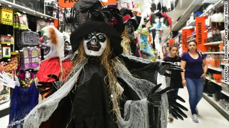 Costumes and props line the aisles at a store selling Halloween merchandise in Alhambra, California on October 23, 2017.  According to a survey from the National Retail Federation which has been conducted annually since 2003, Halloween fans are expected to spend a record $9.1 billion this year, up from the $8.4 billion spent last year. / AFP PHOTO / FREDERIC J. BROWN        (Photo credit should read FREDERIC J. BROWN/AFP/Getty Images)