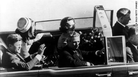 John F. Kennedy's motorcade rides through Dallas before his assassination on November 22, 1963.