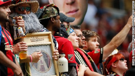 Fans watch the match between the Atlanta United and Toronto FC at Mercedes-Benz Stadium on October 22, 2017.