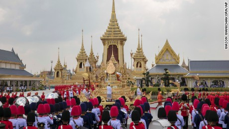 The ceremonial urn of Thailand's late King Bhumibol Adulyadej arrives at the crematorium during the funeral procession as the royal crematorium is seen in the background in Bangkok, Thailand, Thursday, Oct. 26, 2017. (AP Photo/Wason Wanichakorn)