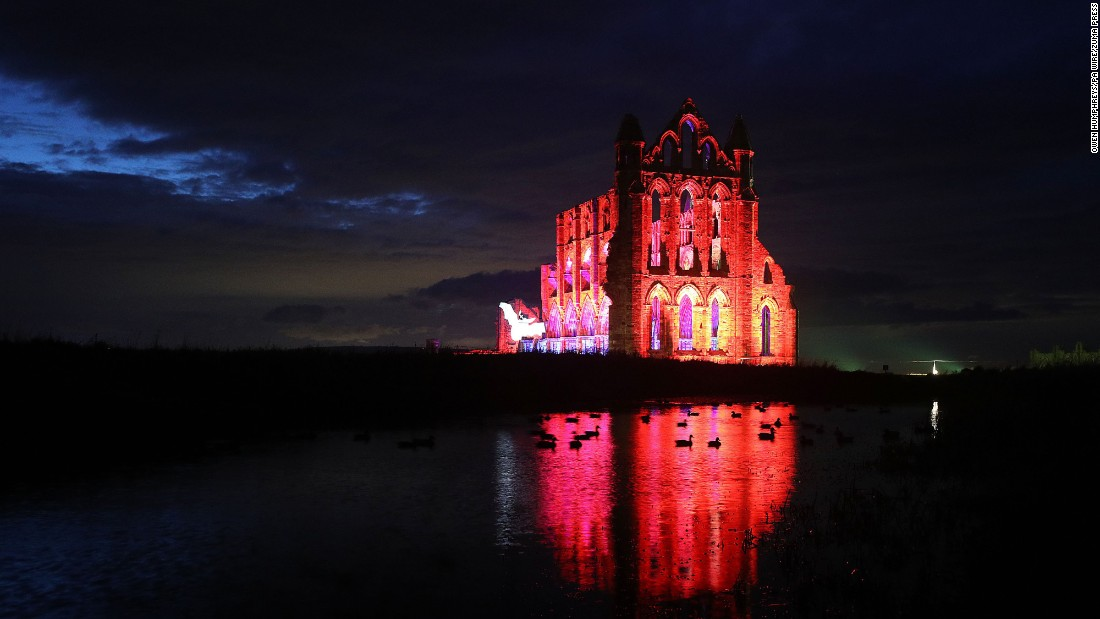 <strong>Whitby, UK:</strong> Whitby Abbey in North Yorkshire, England, is lit up to celebrate Halloween.