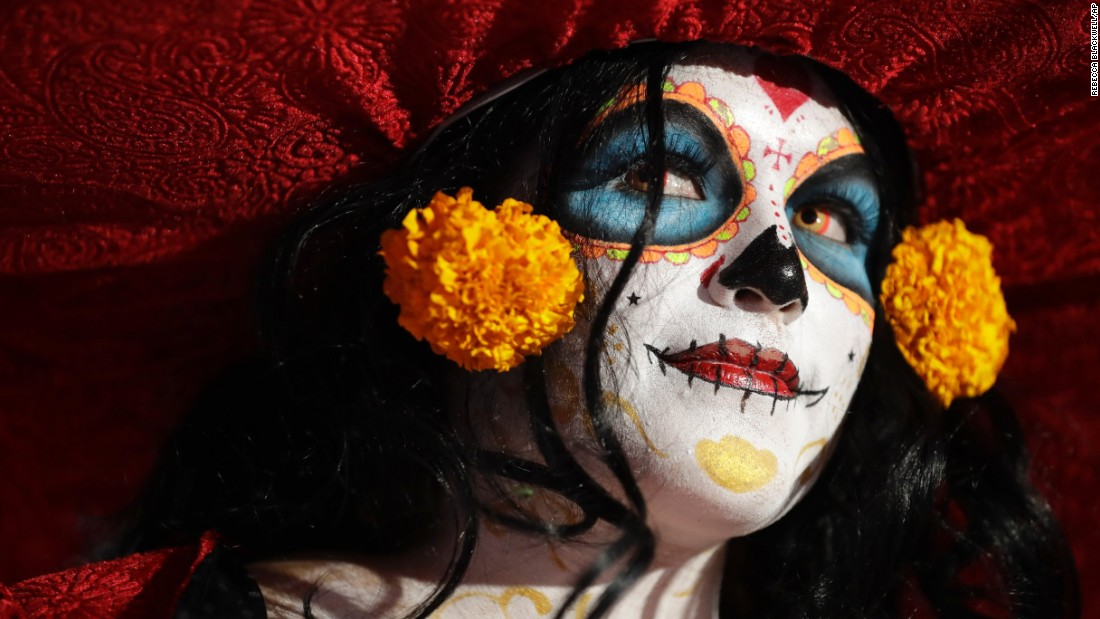A woman dressed as the skeleton figure Catrina waits for a Catrina procession in Mexico City on Sunday, October 22. The march was part of celebrations for the Day of the Dead, a Mexican holiday that begins on October 31.