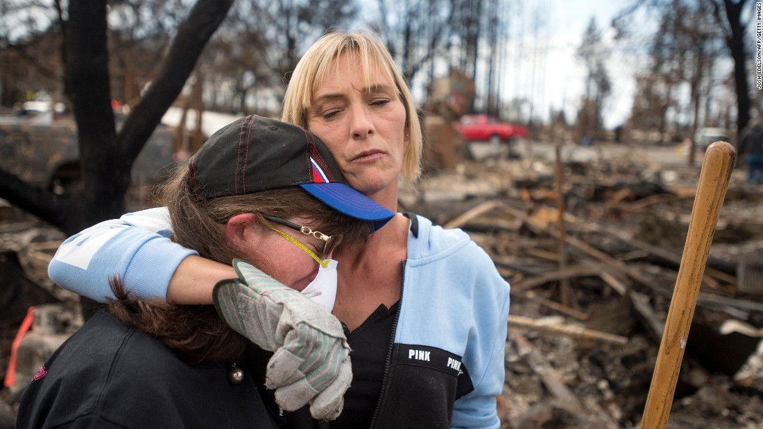 "Tanya Williams, right, consoles neighbor Dawn Lockhart as they view their burned homes in Santa Rosa, California, on Friday, October 20. Thousands of homes and businesses <a href=""http://www.cnn.com/interactive/2017/10/us/california-wildfires-cnnphotos/index.html"" target=""_blank"">have been destroyed by wildfires.</a>"