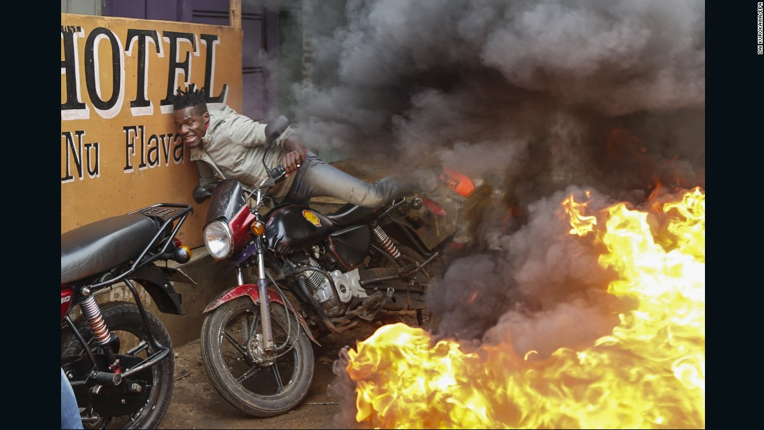 "A man falls from his motorbike as he tries to pass through a burning barricade in Nairobi, Kenya, on Wednesday, October 25. The barricade, set up by supporters of presidential candidate Raila Odinga, was meant to block vehicles from delivering electoral materials to polling stations in the Kibera slum. Odinga, the main opposition candidate, had urged his supporters to boycott the latest election -- the second in less than three months. The first election was annulled by the country's Supreme Court after Odinga said the results were electronically tampered with. But Odinga still decided to boycott <a href=""http://www.cnn.com/2017/10/26/africa/kenya-election-rerun/index.html"" target=""_blank"">the second election,</a> saying the electoral commission had not implemented reforms."