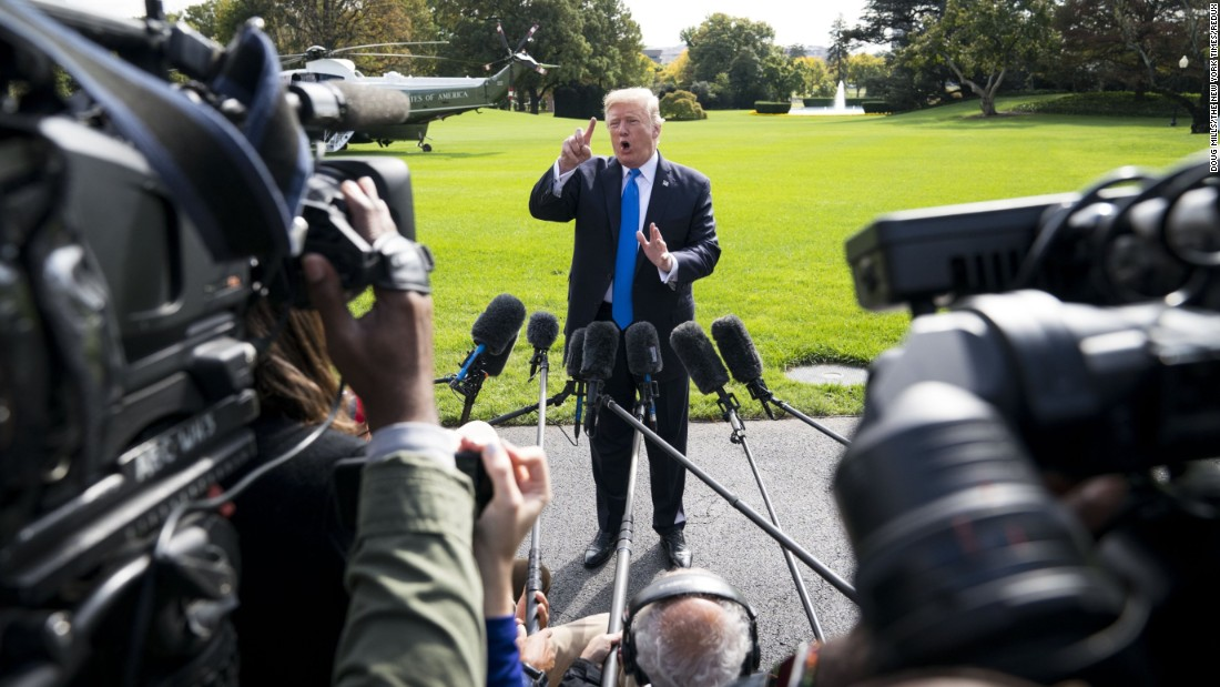 US President Donald Trump speaks to reporters before boarding Marine One in Washington on Wednesday, October 25. Trump was set to fly to Texas to receive a briefing on hurricane recovery efforts.