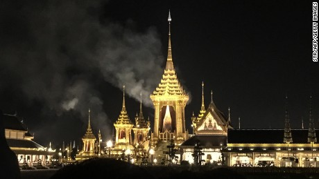 Smoke rises from the main pavilion of the cremation site where the body of late Thai King Bhumibol Adelyadej was being cremated late on October 26, 2017 in Bangkok.