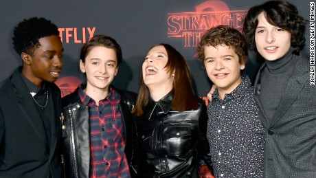 "LOS ANGELES, CA - OCTOBER 26:  (L-R) Caleb McLaughlin, Noah Schnapp, Millie Bobby Brown, Gaten Matarazzo, and Finn Wolfhard attend the premiere of Netflix's ""Stranger Things"" Season 2 at Regency Bruin Theatre on October 26, 2017 in Los Angeles, California.  (Photo by Frazer Harrison/Getty Images)"