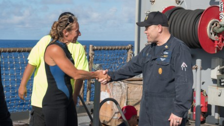 USS Ashland Command Master Chief Gary Wise welcomes aboard Jennifer Appel.
