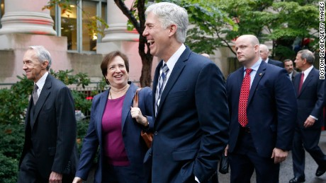 Retired Supreme Court Justice David Souter, left, walks beside Supreme Court Justice Elena Kagan, center, as she and Supreme Court Justice Neil Gorsuch share a laugh together during a procession to mark Harvard Law School's bicentennial in Cambridge, Massachusetts, on October 26, 2017.
