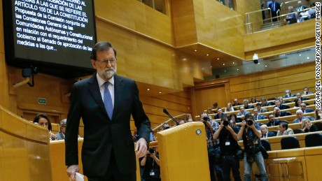 Spain's Prime Minister Mariano Rajoy leaves after giving a speech during a session of the Upper House of Parliament in Madrid on October 27, 2017. The central government has invoked the never-before-used article 155 of the Constitution, designed to rein in rebel regions, as it seeks to end Catalonia's drive to break from Spain. Spain's upper house is in charge of approving or rejecting the power seizure of the semi-autonomous Catalonia region proposed by Madrid.   / AFP PHOTO / OSCAR DEL POZO        (Photo credit should read OSCAR DEL POZO/AFP/Getty Images)