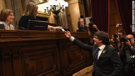 Catalan President Carles Puigdemont casts his vote for independence from Spain on Friday.