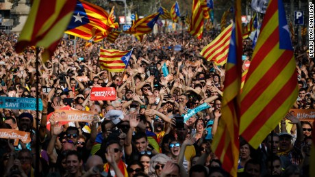 Protesters with Catalan flags take part in a rally in Barcelona, Spain, Friday, Oct. 27, 2017. Catalonia's parliament on Friday will resume debating its response to the Spanish government's plans to strip away its regional powers to halt it pushing toward independence.