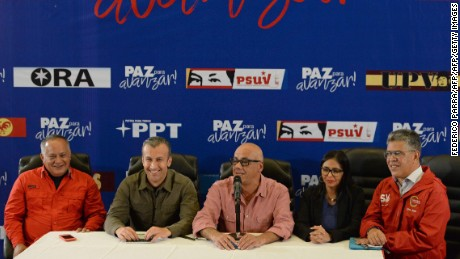 (L to R) Member of the Constituent Assembly Diosdado Cabello, Venezuelan Vice-President Tareck El Aissami, Jorge Rodriguez, mayor of Libertador municipality in Caracas and leader of the pro-government United Socialist Party of Venezuela, president of the loyalist-packed Venezuelan Constituent Assembly, Delcy Rodriguez;  and Minister of Education Elias Jagua offer a press conference, as they wait for the results of the regional elections at the ruling party campaign headquarters in Caracas on October 15, 2017. Millions of Venezuelans voted peacefully in regional elections on Sunday following months of violent protests earlier this year aimed at unseating President Nicolas Maduro. No official turnout figures were available, but an electoral commission source estimated turnout at around 60 percent.  / AFP PHOTO / FEDERICO PARRAFEDERICO PARRA/AFP/Getty Images