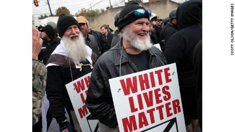 "SHELBYVILLE, TN - OCTOBER 28: People hold signs during a ""White Lives Matter"" rally on October 28, 2017 in Shelbyville, Tennessee. Tennessee Gov. Bill Haslam said state and local law enforcement officials would be out ""in full force"" for the two white nationalist rallies. The event billed as a White Live Matter rally is hosted by Nationalist Front, which is a coalition of several white supremacist organizations.(Photo by Scott Olson/Getty Images)"