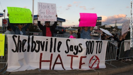 "Shelbyville residents asked passersby to say ""Boo to Hate"" on October 27."