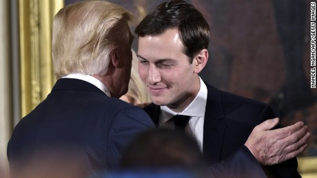 US President Donald Trump (L) congratulates his son-in-law and senior advisor Jared Kushner after the swearing-in of senior staff in the East Room of the White House on January 22, 2017 in Washington, DC. / AFP / MANDEL NGAN        (Photo credit should read MANDEL NGAN/AFP/Getty Images)