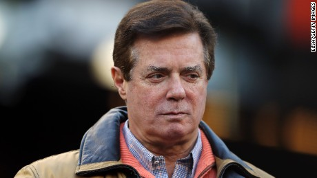 Former Donald Trump presidential campaign manager Paul Manafort looks on during Game Four of the American League Championship Series at Yankee Stadium on October 17, 2017 in the Bronx borough of New York City.
