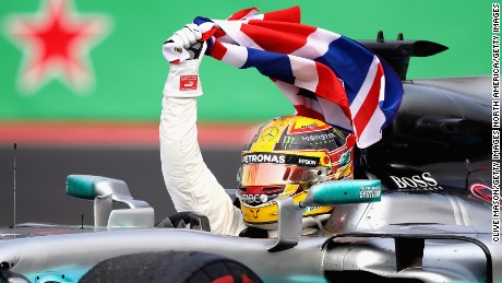 Lewis Hamilton celebrates at the Mexican Grand Prix after winning a fourth F1 drivers' title.