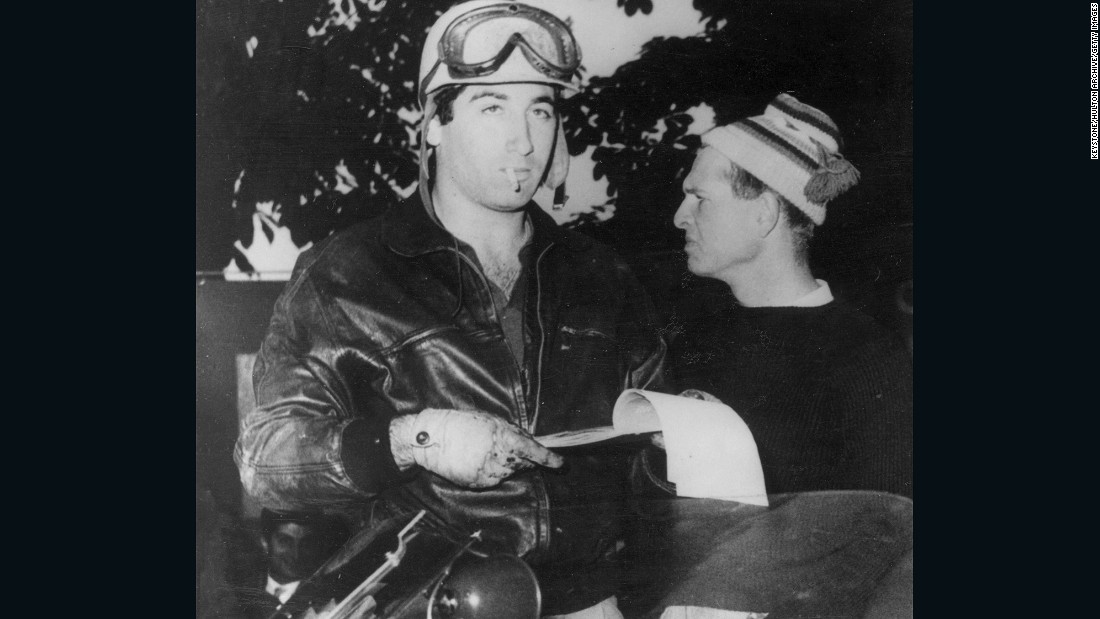 Alfonso de Portago (left), a Spanish aristocrat turned racing driver, with Collins before the start of Italy's Mille Miglia. Portago was killed when he crashed towards the end of the 1,00-mile road race. The tragedy also took the life of his co-driver and 10 spectators, which included five children. The accident led to banning of the race.