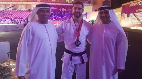 UASE Judo Federation president Mohammad Bin Thaloub Al-Darei poses with Israeli bronze medalist Peter Paltchick and Mr. Aref Al-Awani, General Secretary of Abu Dhabi Sports Council.