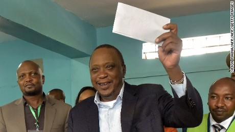 Kenya's President Uhuru Kenyatta casts his ballot as he votes at a polling station at Mutomo primary school in Kiambu on October 26, 2017 as polls opened for the presidential elections. / AFP PHOTO / SIMON MAINA        (Photo credit should read SIMON MAINA/AFP/Getty Images)