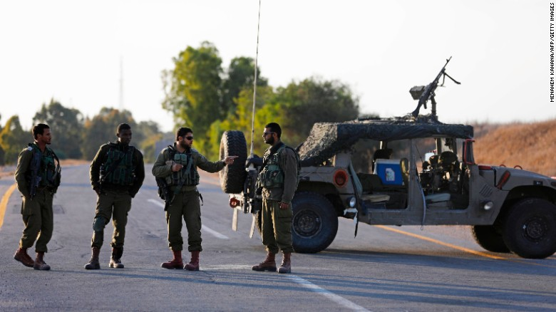 Israeli soldiers block a road close to the Israeli border with Gaza on October 30 in southern Israel. The Israeli military blew up a tunnel leading into Israel from Gaza.