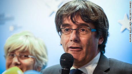 Catalonia's dismissed leader Carles Puigdemont addresses reporters in Brussels last month.