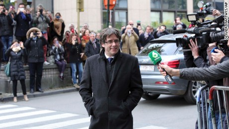 Sacked Catalonian President Carles Puigdemont arrives for a press conference in Brussels on Tuesday.