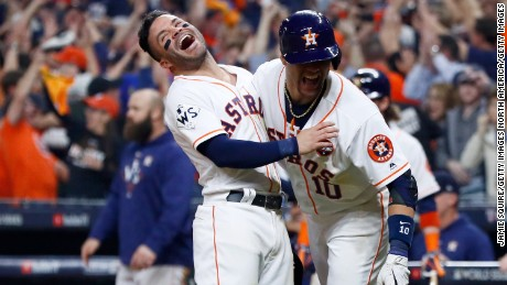 HOUSTON, TX - OCTOBER 29: Jose Altuve #27 and Yuli Gurriel #10 of the Houston Astros celebrate after a two-run home run by Carlos Correa #1 (not pictured) during the seventh inning against the Los Angeles Dodgers in game five of the 2017 World Series at Minute Maid Park on October 29, 2017 in Houston, Texas.  (Photo by Jamie Squire/Getty Images)