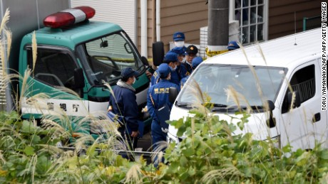Policemen gather in front of an apartment where Japanese police found nine bodies, including two with their heads severed and dumped in a cool box, in Zama, Kanagawa prefecture, on October 31, 2017. The bodies were of eight women and one man, several media reported. / AFP PHOTO / Toru YAMANAKA        (Photo credit should read TORU YAMANAKA/AFP/Getty Images)