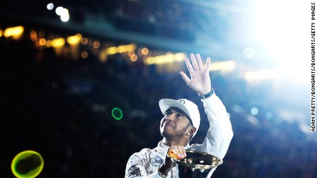 STUTTGART, GERMANY - DECEMBER 12: Lewis Hamilton of Great Britain and 2015 F1 World Champion waves to the crowd before the first round of races in the Mecedes-AMG A 45 of the Stars and Cars event at Mercedes-Benz Arena on December 12, 2015 in Stuttgart, Germany.  (Photo by Adam Pretty/Bongarts/Getty Images)