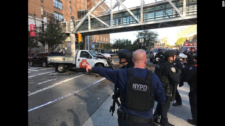 New York City police work in Manhattan after a rental truck drove down a busy bicycle path and struck people on Tuesday, October 31. At least eight people were killed and nearly a dozen were injured in the incident, which is being investigated as terrorism, according to multiple law enforcement sources. A suspect is in custody.