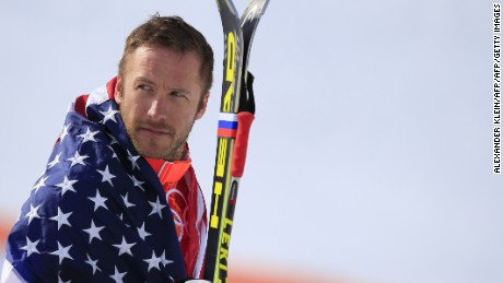 Bronze medallist US skier Bode Miller arrives on the podium during the Men's Alpine Skiing Super-G Flower Ceremony at the Rosa Khutor Alpine Center during the Sochi Winter Olympics on February 16, 2014.   AFP PHOTO / ALEXANDER KLEIN        (Photo credit should read ALEXANDER KLEIN/AFP/Getty Images)