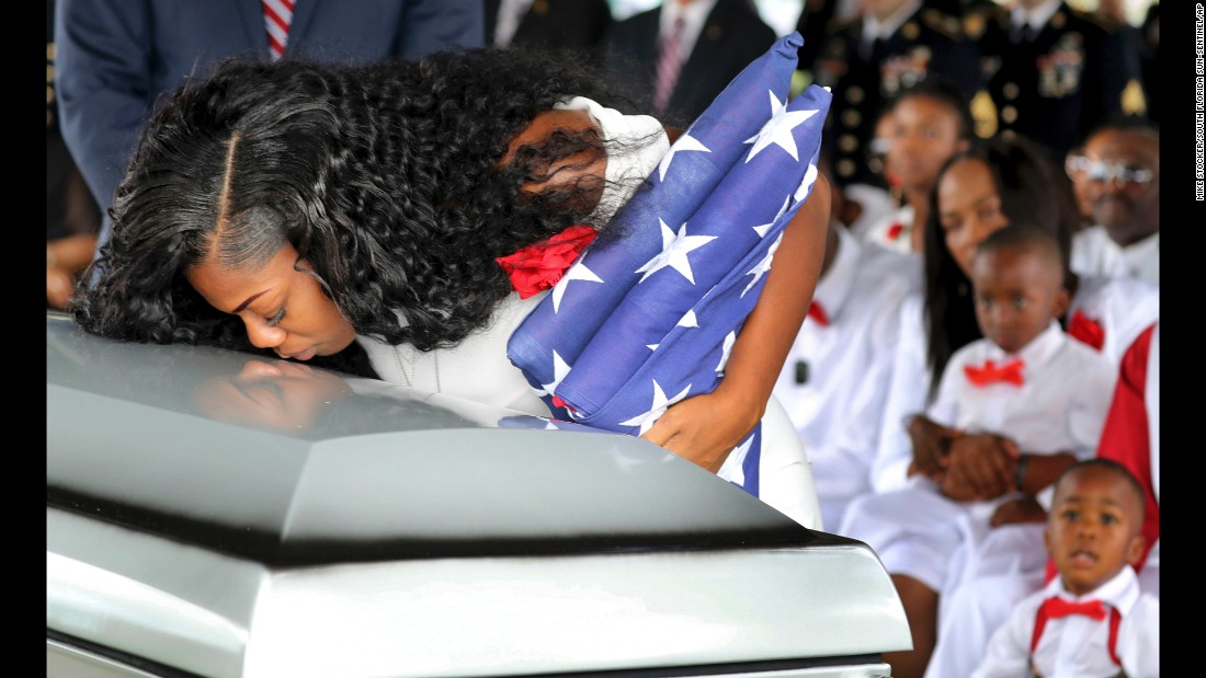 "Myeshia Johnson kisses the casket of her husband, Army Sgt. La David Johnson, during <a href=""http://www.cnn.com/2017/10/21/us/sgt-la-david-johnson-funeral/index.html"" target=""_blank"">his burial service</a> in Hollywood, Florida, on Saturday, October 21. Sgt. Johnson and three other American soldiers were killed in an ambush in Niger on October 4."