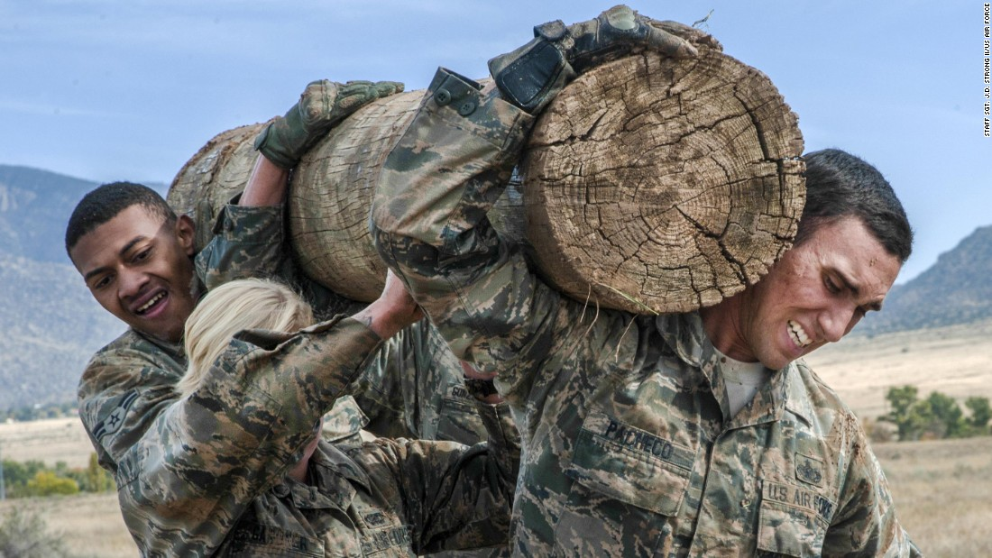 US airmen carry a log during the Manzano Challenge, a skills competition held at New Mexico's Kirtland Air Force Base on Friday, October 27.