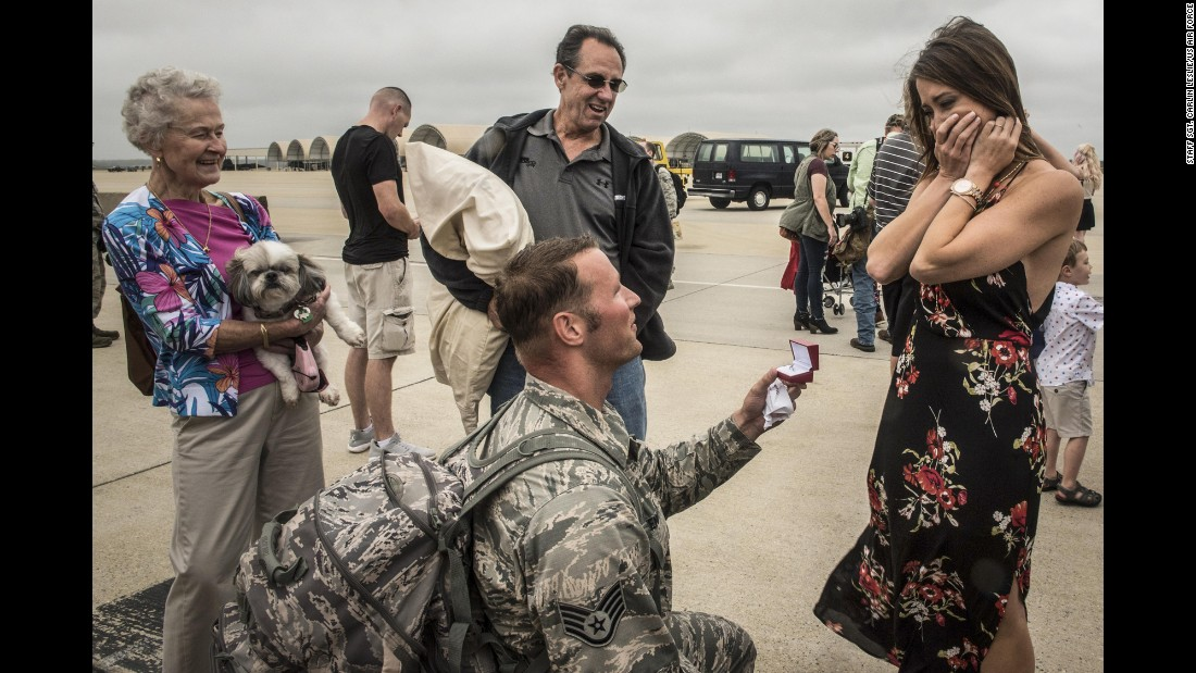Air Force Staff Sgt. Jeff Greenquist proposes to his girlfriend, Ashley Branham, after returning from a six-month deployment to the Middle East on Thursday, October 12.