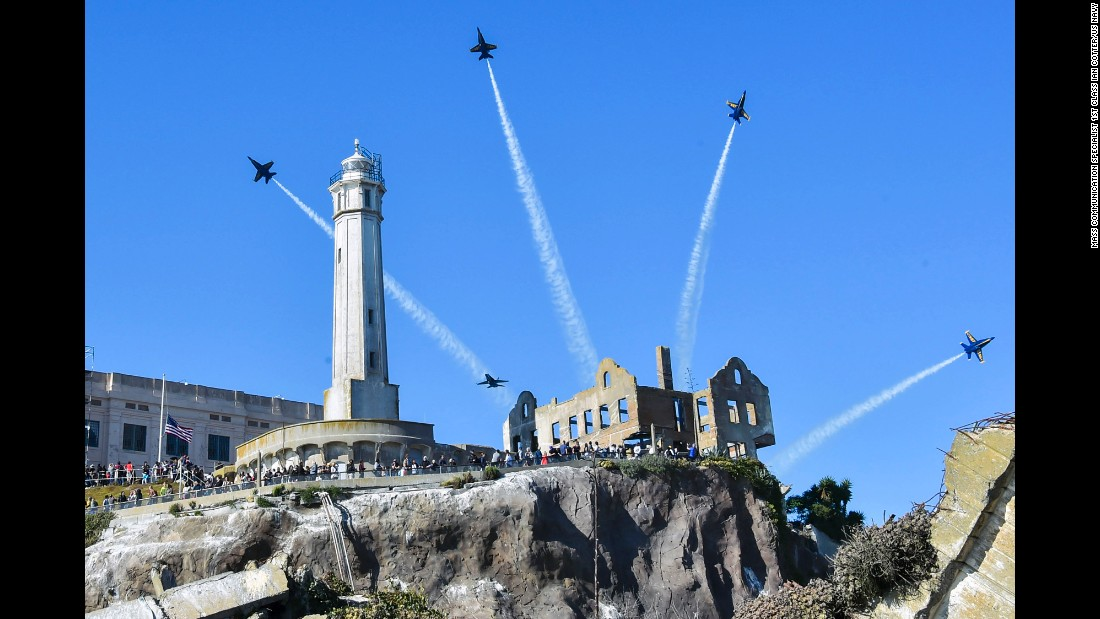 The Blue Angels, the US Navy's fight demonstration squadron, fly over Alcatraz Island during San Francisco Fleet Week on Sunday, October 8.