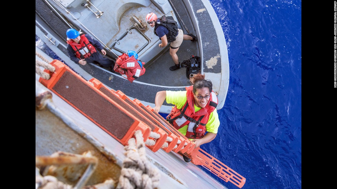 "Tasha Fuiava climbs aboard the USS Ashland after the Navy ship rescued her and fellow American Jennifer Appel in the Pacific Ocean, about 900 miles southeast of Japan, on Wednesday, October 25. The two women <a href=""http://www.cnn.com/2017/10/31/asia/pacific-sailors-jennifer-appel-tasha-fuiava-questions/index.html"" target=""_blank"">said they had been stranded on a crippled sailboat</a> for more than five months."