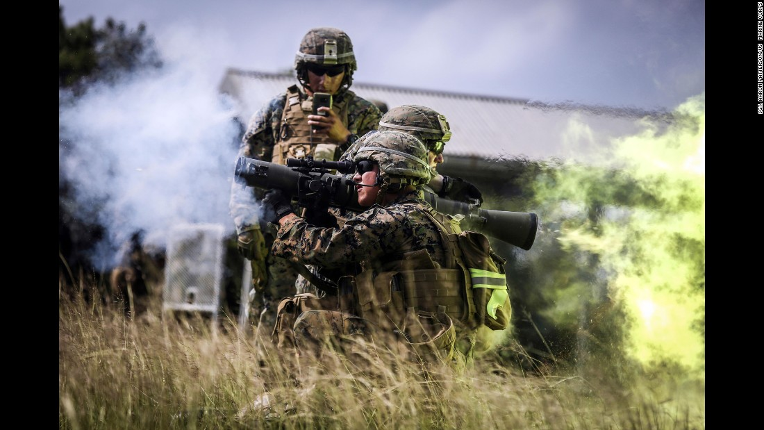 Marine Lance Cpl. Luis Arana fires a weapon while training at Camp Hansen in Japan on Wednesday, October 25.
