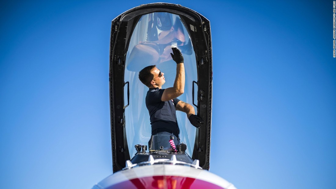 Air Force Staff Sgt. Kyle Smith cleans condensation off an aircraft canopy at Georgia's Moody Air Force Base on Friday, October 27. Smith is part of the Thunderbirds, the Air Force's flight demonstration team.
