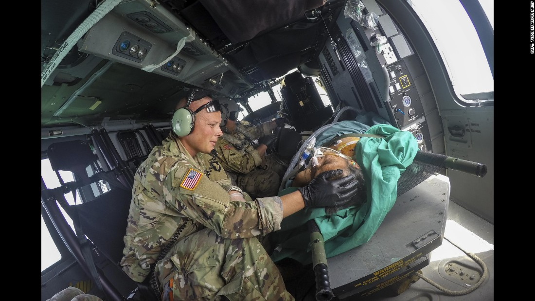 Army Capt. Benjamin Stork cares for a patient aboard a helicopter headed for the USNS Comfort, a hospital ship off the coast of Puerto Rico, on Friday, October 20.