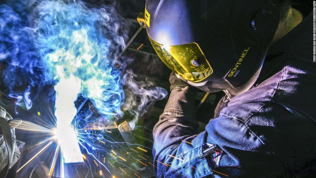 Navy Petty Officer 3rd Class Jose Rodriguez welds brackets together aboard the USS Ronald Reagan, off the coast of Japan on Monday, October 30.