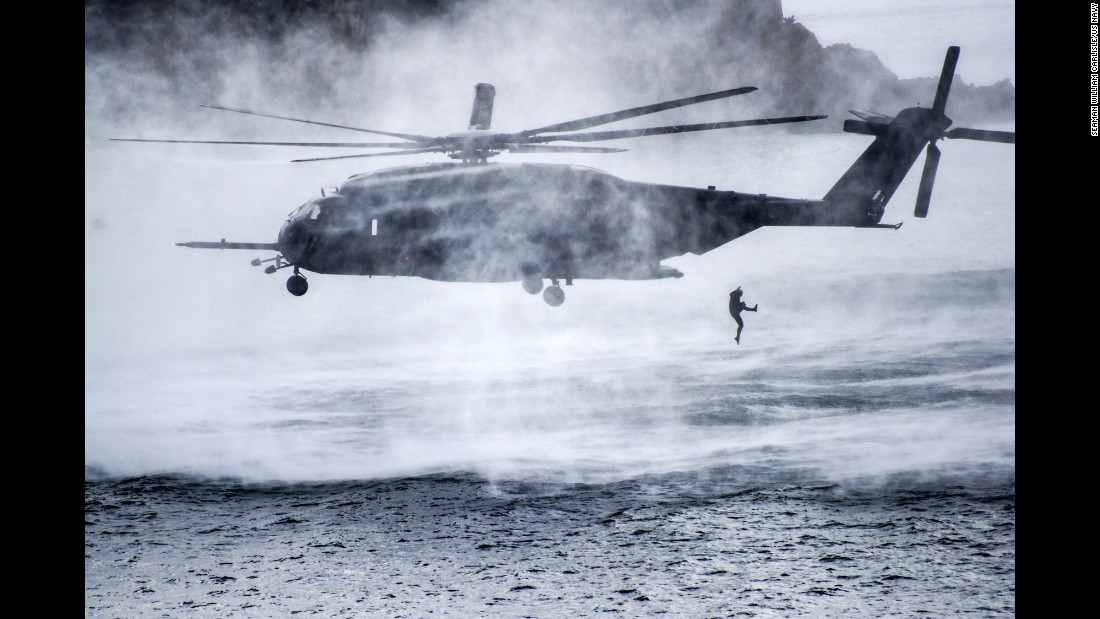 A service member jumps from a Navy helicopter during a mine-warfare training exercise in Busan, South Korea, on Thursday, October 19.