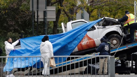 The Home Depot truck used in the bike path attack is removed from the crime scene, Wednesday, Nov. 1, 2017, in New York. (AP Photo/Mark Lennihan)