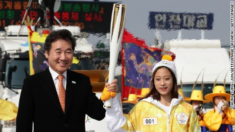 INCHEON, SOUTH KOREA - NOVEMBER 01:  South Korean prime minister Lee Nak-yon and First torch bearer, South Korean figure skater You Young hold the  PyeongChang 2018 Winter Olympics torch during a torch relay on November 1, 2017 in Incheon, South Korea.  (Photo by Chung Sung-Jun/Getty Images)