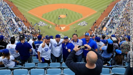LOS ANGELES, CA - NOVEMBER 01:  Fans take a photograph before game seven of the 2017 World Series between the Houston Astros and the Los Angeles Dodgers at Dodger Stadium on November 1, 2017 in Los Angeles, California.  (Photo by Sean M. Haffey/Getty Images)