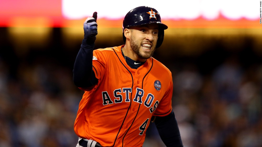 George Springer celebrates after hitting a home run to give the Astros a 5-0 lead in the second inning. The two-run blast was Springer's fifth home run of the series, tying a World Series record. He was later named World Series MVP.