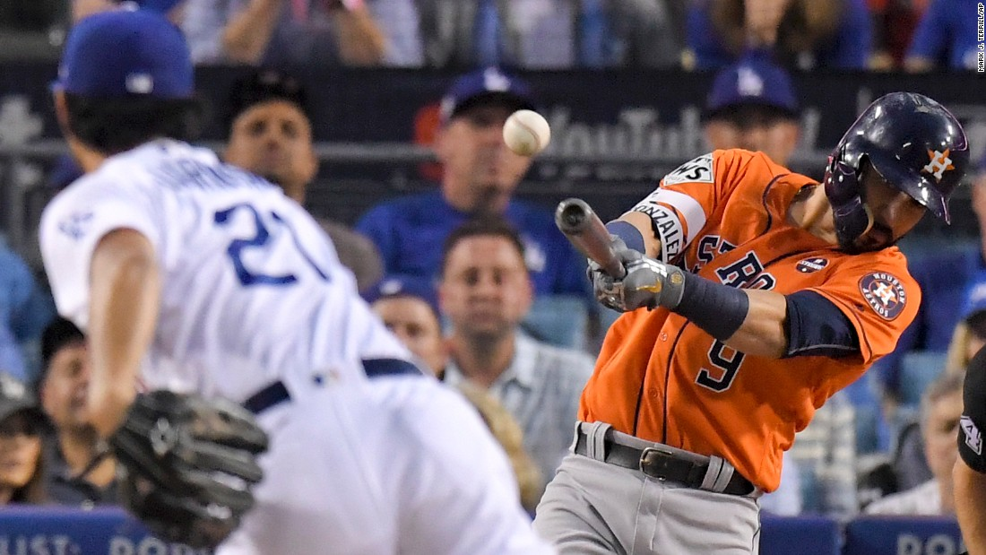Marwin Gonzalez hits a double off Dodgers starting pitcher Yu Darvish early in the second inning.