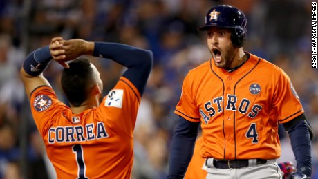 George Springer of the Houston Astros, right, celebrates with teammate Carlos Correa in Game 7 of the World Series.