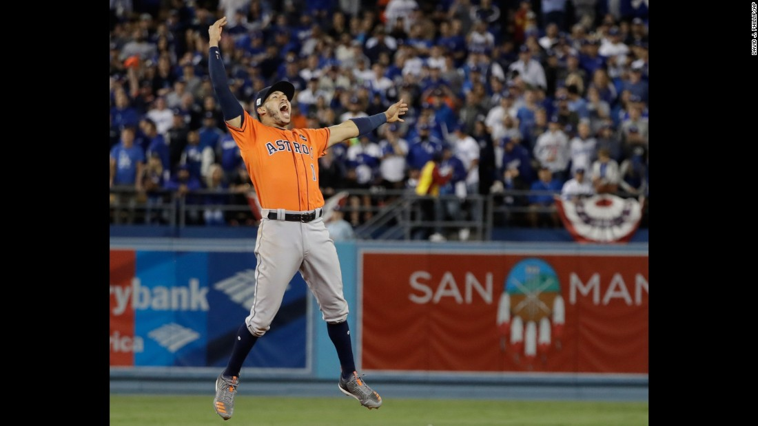 Houston shortstop Carlos Correa leaps for joy after the final out.